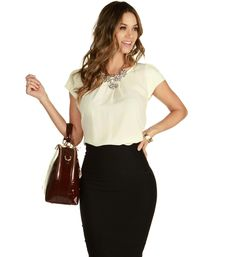 """Show them you mean business when you show on time and stylin'. This airy cap sleeve blouse features a flutter detail sleeve and pleated necklace with keyhole back. Styled with a pencil skirt and pointy pumps for a serious business look.*Approximately 13"""" side seam*100% PolyesterHand wash cold. Do not bleach. Line dry."""