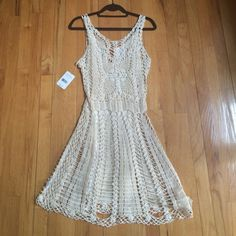 White Lace Knit Dress This is a beautiful, well-made Free People knit dress. Comes with a white slip to put underneath. New with tags. Very boho style. Please ask questions if you have any! Free People Dresses