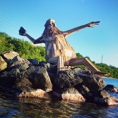Hector el protector by Thomas Dambo  Made entirely from scrap wood and pallets.