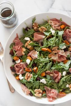 A fall Roasted Butternut Squash Salad loaded with roasted vegetables, salty prosciutto, nuts and goat cheese - it's the perfect comforting fall salad.