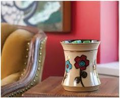 Ashbury full size warmer. Retro, color-blocked daisies add bohemian style to a classic shape in natural taupe.