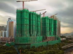 Photos of Hong Kong Construction Sites Wrapped in Colorful Silk Cocoons by Peter Steinhauer