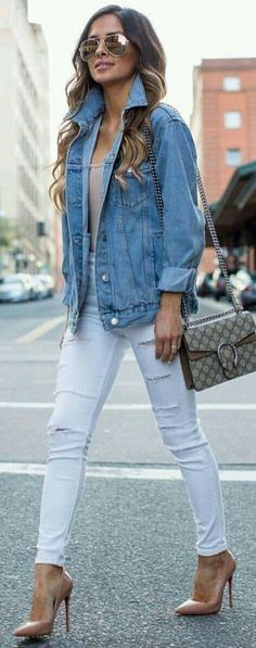 Denim jacket with white jeans.