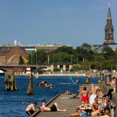 A nice sunny day by the habour bath in Copenhagen. You can almost take a swim everywhere in the Copenhagen Habour - there are habour baths different places in the city. Check out this top 10 baths and beaches in Copenhagen: http://www.visitcopenhagen.com/copenhagen/children/top-10-baths-beaches  Photo: Thomas Rousing #Copenhagen #habourbath