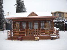 casa in legno, con veranda
