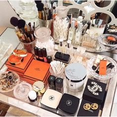 An Incredible Closet with this gorgeous dressing table, piled high with Chanel and Hermes. Interior Design: Luxe Report Designs. https://instagram.com/p/0G-3iNslPl/