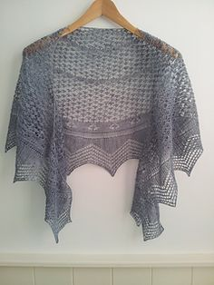 Blue Moon is a crescent shaped shawl on a garter stitch ground, based on a bead pattern and with a knitted on Vandyke lace edging. Because of the garter stitch ground and the nature of the lace pattern the shawl has no right or wrong side.