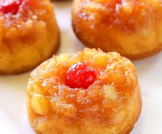 Pineapple Upside Down Cupcakes - a mini version of your favorite cake with butter, brown sugar, pineapple, and a cherry on top! the-girl-who-ate-everything.com