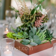 Half of the tables were topped with these copper trays filled with reindeer moss, white lisianthus, pink astilbe, and dogeye euphorbia.