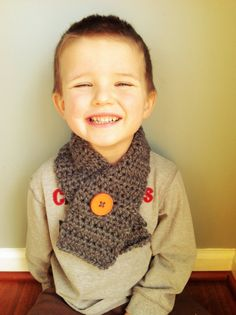 A button- what a great idea!  Don't you think so @Ashley Walters Bunn ?  Gray Boys Scarf  by craftedingrace on Etsy, $12.00