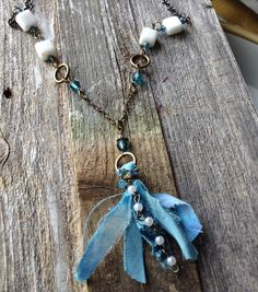 $26 Teal Crystals and White Calcite create this one of a kind tassel necklace. For more come to my shop. . . A personal favorite from my Etsy shop https://www.etsy.com/listing/270595101/y-necklace-with-calcite-teal-crystals