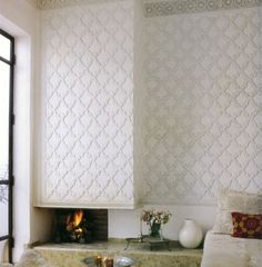 Morrocon with a modern twist. like texture and pattern for a fireplace surround
