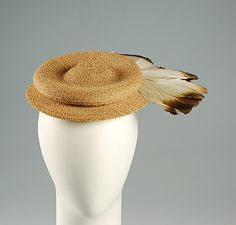 Hat Sally Victor (American, 1905–1977)  Date:     1944 Culture:     American Medium:     Straw (possibly sisal), feathers