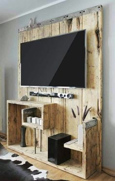 awesome idea, instead of damaging the wall i can hide everything behind the wood (Diy Art Rustic)