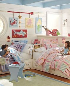 boy and girl room- cute beds and I like the  way they are arranged.  Need to redo Sky's room so she can share with baby brother.