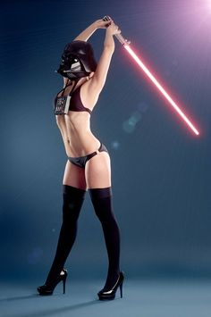 Hot Female Darth Vader Stretches with a Lightsaber
