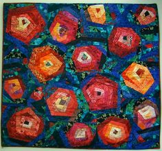 """Takoma Nights"", 48 x 45"", by Carrie at Chez Tuna. Made to represent a rose garden; log cabin variation 