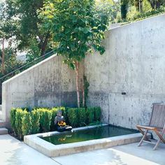 Photo: Tim Street-Porter | thisoldhouse.com | from All About Retaining Walls. Nice concrete look