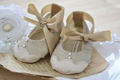 I absolutely love everything from SugarPlumTree on Etsy!  If I have a girl, I want to order little shoes for her.  The hard thing would be choosing which style!