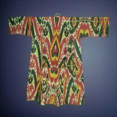 IKAT CHAPAN COAT - garment worn by men and women and children,  Central Asia,Uzbekistan, Afghanistan, Tajikistan, Kazakhstan, Kyrgyzstan, Pakistan  Ikat  - woven - cotton and silk (20 century)....Private Collection