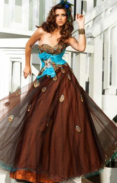 94fa6e92ac6 Make a statement with this chocolate and turquoise Tony Bowls Evenings  TBE11200. With peacock feathers