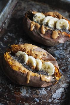 Breakfast baked sweet potatoes stuffed with creamy almond butter, banana slices, and chia!