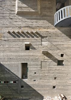 Textured concrete facade of Petralona, a house on a Greek island by Supreme Point Architects (Athens)