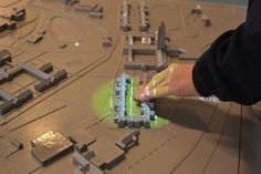 Multi-sensory 3D maps give spoken directions and building information when touched, along ...