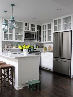 Replace solid cabinet doors with glass ones. Glass fronts lighten the look of cabinetry and allow the eye to travel through to the back, which helps the kitchen seem more expansive. Just don't clutter the interiors or you will defeat the purpose.  43 Extremely creative small kitchen design ideas