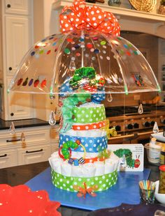 Diaper cake using umbrella and acrylic rain drops for baby shower baby sprinkle