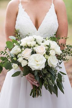 Bridal bouquet (roses, garden roses, spray roses, lisianthus & eucalyptus). Photo by Michelle Huber Photography.