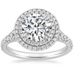 This stunning engagement ring features a mesmerizing double halo of pave-set diamonds and elegant double claw prongs. The split-shank band highlights the chic, structural gallery (average 0.60 total carat weight).