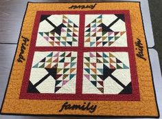 """""""Forever Blessed"""" pieced cotton background with wool applique words on borders.  Measures 42-1/2"""" square.  Kits available at Sewing Seeds Quilt Co."""