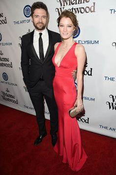 Perfect couple: Topher Grace seemed proud to be escorting fiancee Ashley  Hinshaw who delig.