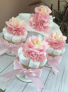 This listing is for a set of 3 mini diaper cakes, blush pink and gold, with artificial roses toppers. Each is made with 8 diapers size 2, decorated with ribbon, shredded paper, and artificial roses. (Please note that depending on availability, roses may be. Bit different from shown in