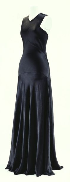 """Evening Dress, Madeleine Vionnet: 1932, bias-cut silk satin. """"...Vionnet's stretching and smoothing of the fabric in advance, along with her artistic cutting and sewing skills, kept the shape of the dress after its construction. The bias cut became a useful technique in the 1930s, when consciousness of body line was revived in fashion. As though Vionnet were an anatomist, her grasp of the body's form using her characteristic split line and bias cut fabric personified innovative g..."""