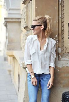 white shirt and a high pony