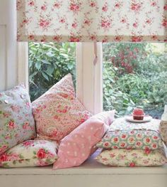 floral window seat. Love the sweet feminine fabrics. Looks so cozy- I could spends hours here!