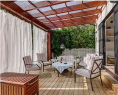 Combination of pergola and draped curtains and awning.