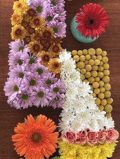 Pave' of daisy mums, cremone-type mums, crespida, spray roses, gerbera daisies.