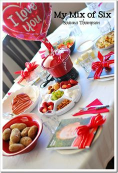 An adorable idea for a valentines day family dinner. Love the photo books!