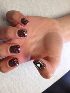 Brown with red and silver glitter fade and penguin design on thumb Oasis Salon and Spa Mill Hall Pa (570)726-6565
