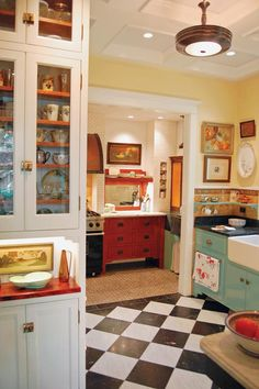 """Inside the cooking nook, the custom-made sideboard was based on an old flea-market find that Doug had passed on to his sister. """"Everything that was wrong with it we fixed in the new version,"""" he says."""