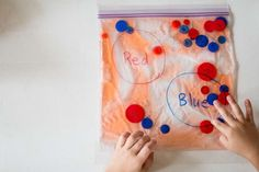 I created a simple sensory bag with buttons and it turned into a color sorting game for the kids during one of the 7 Day Challenges. The challenge was to make a sensory bag! The sensory bag is simply just hair gel in a Ziploc bag. You could double bag it to seal it better. I inserted two colors of buttons into each sensory bag and taped it to the table. Here's a quick video: I created two of these so Louis and George could both play with them, but it turned out to be fun for Henry too. Fo...