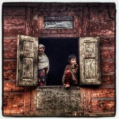 Woman & Child Looking from a Window in Kishtwar, Kashmir Perspective Photography, Life Photography, A Passage To India, Kashmiri Shawls, Kashmir India, Srinagar, Paradise On Earth, Hill Station, Woman Reading