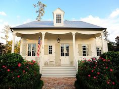 Google Image Result for http://blog.hgtv.com/design/files/2010/06/RMS_TABCAD-white-front-porch-house-exterior500.jpg