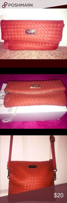 Nine West Cross body clutch Shoulder cross body clutch,with magnetic snap fold over and adjustable strap.not in a box,close to new😀 the colour is like coral India not really brown. Bags Clutches & Wristlets