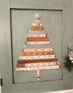 vintage folding ruler Christmas tree topped with vintage rhinestone button affixed to salvaged cabinet door