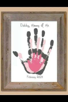 Dad, Mom, & Baby hand print painting.