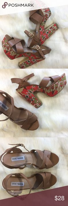 """Steve Madden Kia Fabric Platform Sandals Size 10 Steve Madden Kia Fabric Platform Sandals. Size 10. Good used condition – some signs of wear (see photos). Orange and green retro print fabric and chunky platform heel. Wear these sandals with flared jeans and embroidered peasant blouse for a 70s inspired look! (See Calvin Klein flare jeans in separate listing.) No trades, offers welcome.  Approximate measurements: Heel 6""""   Platform 2"""" Steve Madden Shoes Platforms"""
